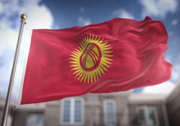 Kyrgyzstan Flag 3D Rendering on Blue Sky Building Background