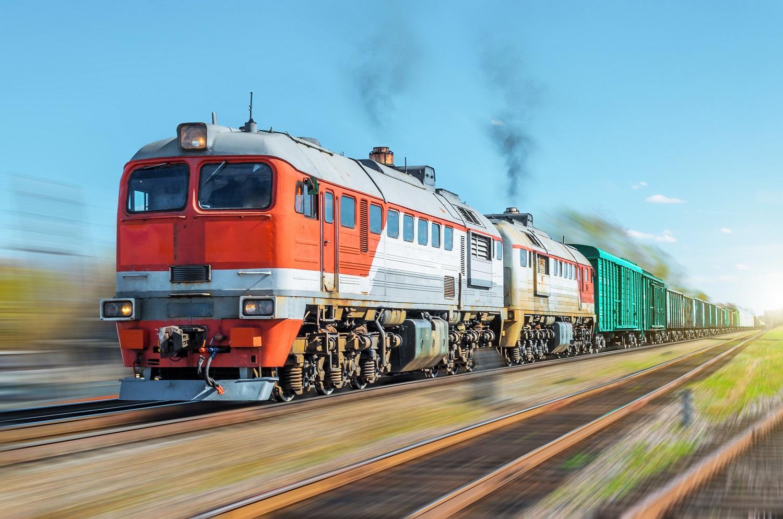 Freight train blur motion railroad embankment rail.