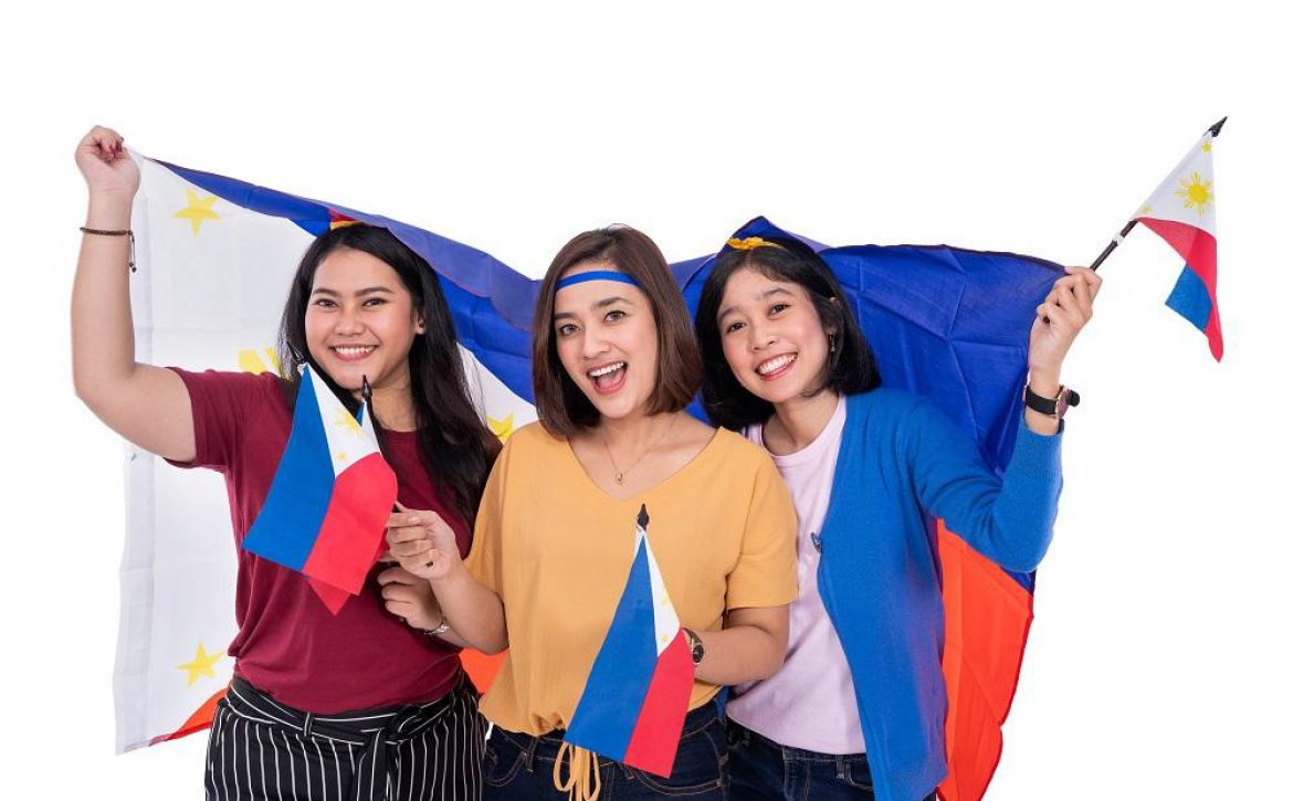 filipino woman holding philippines national flag