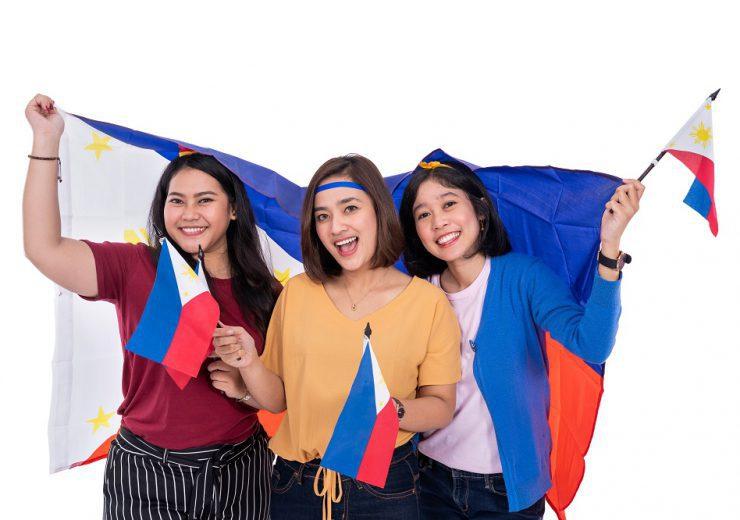 filipino woman holding philippines national flag