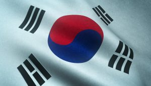 A closeup shot of the waving flag of South Korea with interesting textures